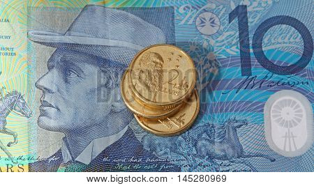 An Australian ten dollar note with Australian two dollar coins.