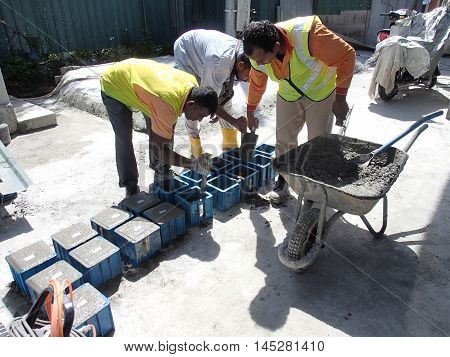 MALACCA, MALAYSIA - SEPTEMBER 28, 2015: Cube test. Concrete mould for checking of concrete quality work or compression tests. Cube shape type.