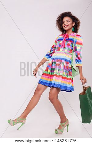 Cute Afro American Young Woman With A Shooping Bag In Hand