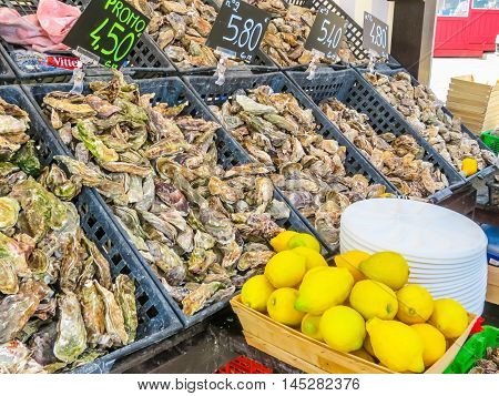 CANCALE, FRANCE -MAY 03, 2014: Fresh oysters in oyster market, Cancale, France
