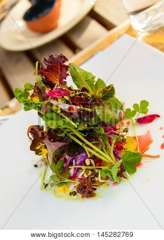 Healthy salad with flowers in a restaurant