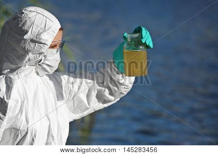 Woman with flask for expertise. Environmental pollution concept