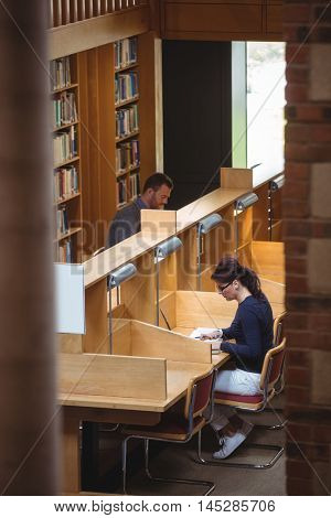 Mature student studying in library at the college