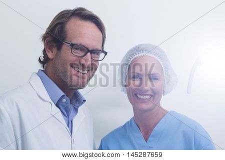 Portrait of dentist and dental assistant wearing surgical mask at the dental clinic