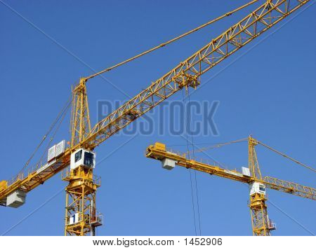 Two Cranes At Work