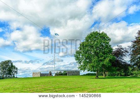 BANNOCKBURN SCOTLAND - August 29 2016: The Rotunda and Saltire flagpole at the Battle of Bannockburn visitors attraction Bannockburn Stirlingshire Scotland.