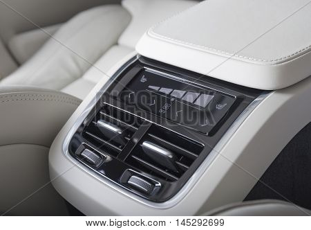 Car interior ventilation and AC control panel for backseats passengers