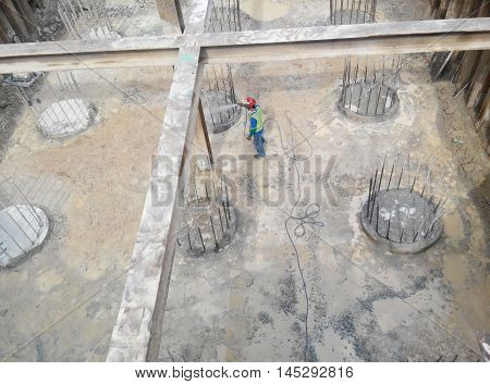 JOHOR, MALAYSIA -MARCH 28, 2015: Excavated and cut to level bore pile at the construction site. Ready to construct pile cap reinforcement bar as next step of work.