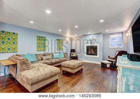 Pastel Blue Walls In Basement Living Room Interior.