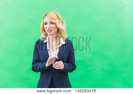 Young woman standing engaged in business education. Wearing blue suit she has blonde hair and blue or blue eyes on a white background. Smile always smiling.
