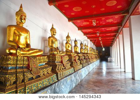 Golden buddha statues located in Wat Pho temple in Bangkok, Thailand.