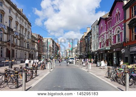 Cardiff United Kingdom Wales - August 26 2016: Tourists and locals going shopping in St Mary Street on Friday morning. The road is the home of a number of shops bars night clubs and restaurants as well as branches of many major banks.