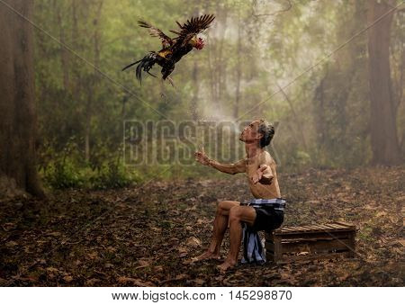 Asian farmer training his fighting by water