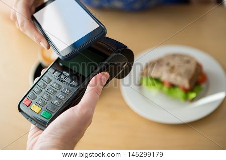 Close-up of hand making a payment through NFC technology
