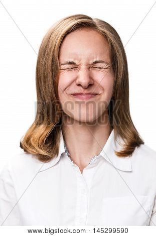 Close-up portrait of a woman showing grimace isolated on white
