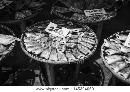 Dry Sepat Siam Fish, Raw Food Thailand Style, Black And White High Contrast Picture Style, With Tag