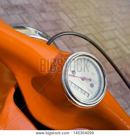 Retro vintage motorcycle handlebar controls including speedometer