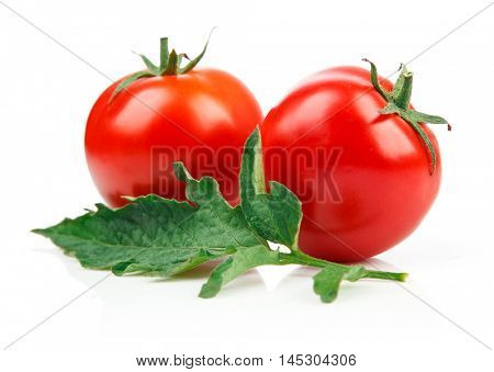 Red tomatoes with green leaf. Isolated on white background