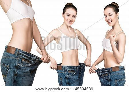 Young slim woman in oversized blue jeans over white background