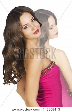 Photo of young woman with beauty long curly hair. Fashion model posing at studio.