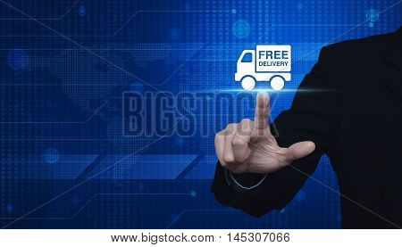 Businessman pressing free delivery truck icon over digital world map Logistic transportation concept Elements of this image furnished by NASA