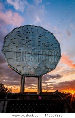 Big Nickel landmark in Sudbury, Ontario, Canada during sunset