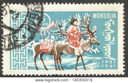 MOSCOW RUSSIA - CIRCA AUGUST 2016: a stamp printed in MONGOLIA shows a postman on Reindeer (Rangifer tarandus) the series
