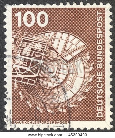 MOSCOW RUSSIA - CIRCA AUGUST 2016: a stamp printed in GERMANY shows brown coal conveyor excavator the series