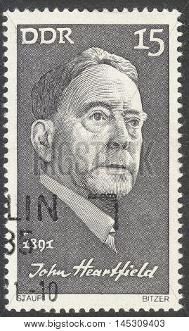 MOSCOW RUSSIA - CIRCA AUGUST 2016: a stamp printed in DDR shows a portrait of John Heartfield the series