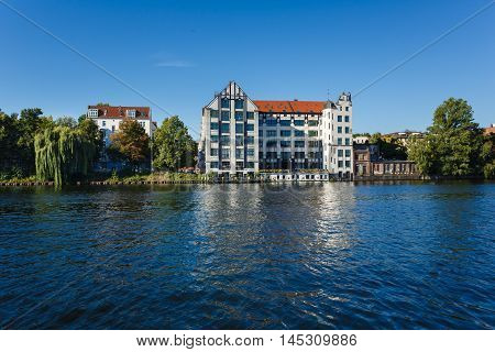 Berlin Germany - August 28 2016: Old building on the banks of the River Spree located on the Pfuelstrasse 5 view from the Berlin Wall