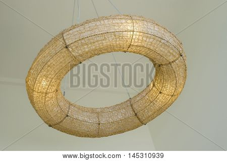 donut warm lamp made from a rattan hanging on ceilinginterior design