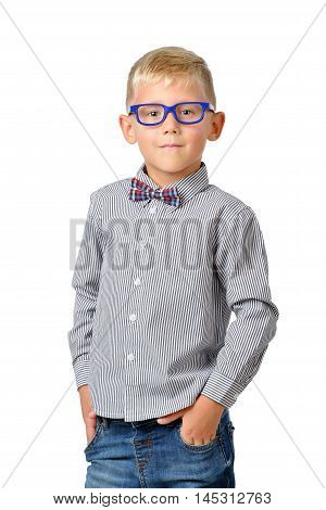 Portrait serious boy wearing glasses and bowtie posing. Educational concept. Isolated over white. School preschool