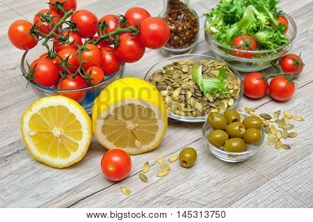 fresh food to cook vegetable salad on a wooden background. horizontal photo.