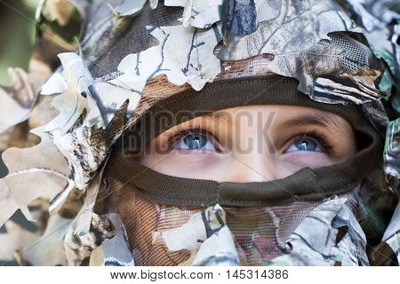 Little Girl In Military Helmet