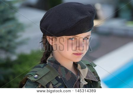 Young Girl In Army Camouflage
