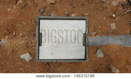 concrete manhole on ground and stone background