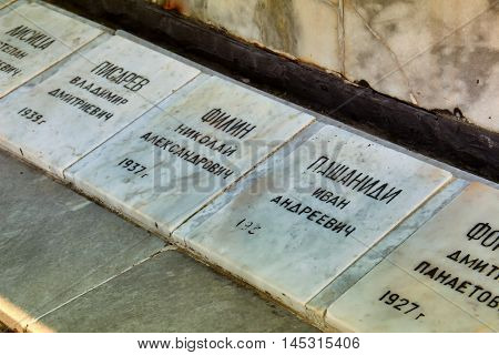 GELENDZHIK, RUSSIA - NOVEMBER 6, 2015: Plates with names of monument to fallen sailors of crew of seiner Toporok in Feb 6 1966 at sea in storm. On memorial there is names of all dead fishermen on November 6, 2015 in city-resort Gelendzhik, Russia