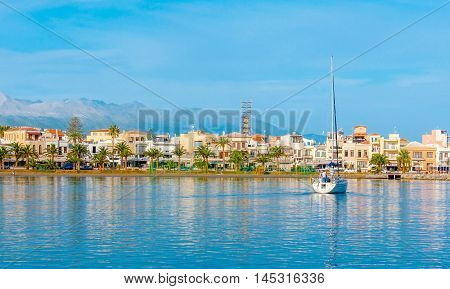 The sailing yacht begins the trip at the coast of old Rethymno Crete Greece.