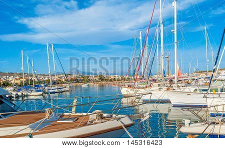 The rows of white yachts in the new port the nice place to enjoy the views and choose the boat for the trip Rethymno Crete Greece.