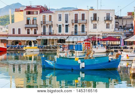The old harbor is surrounded by the small cottages occupied with the best fish and sea food cafes and taverns Rethymno Crete Greece.