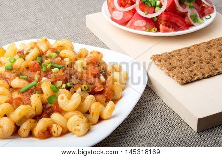 Cavatappi Pasta With Sauce Of Stewed Vegetables Closeup