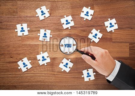 Human resources concept - peace of puzzle. Recruiter or headhunter look for you. Customer oriented marketing and individual marketing concept.