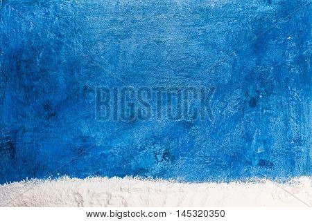 Frame of flour scattered like snow on the spotty blue background