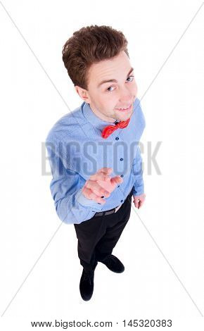 Smiling businessman in a bow tie looking up. top view. Satisfied businessman shakes his finger.