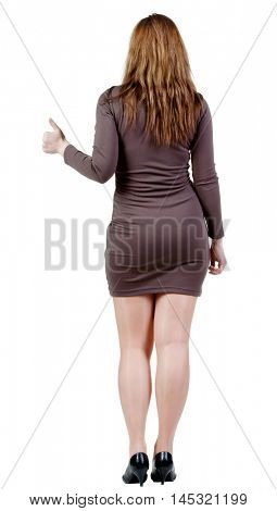 back view of woman thumbs up. rear view. Isolated over white . Rear view people collection. backside view of person. Isolated over white background.