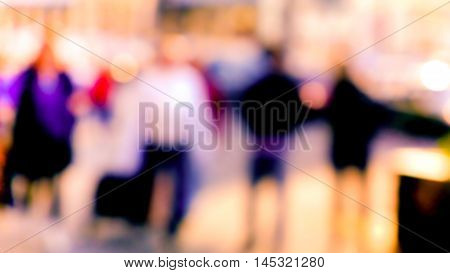 City commuters. Blurred image of workers going back home after work. Unrecognizable faces, bleached effect.