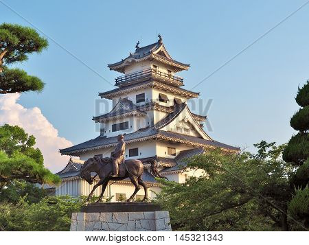Statue of Todo Takatora and his castle - Imabari Castle. Imabari Castle is a Japanese castle in Imabari, Ehime Prefecture, Japan. This castle is well known as one of the three water castles in Japan.