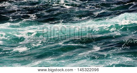 Seascape with turquoise Atlantic Ocean and waves