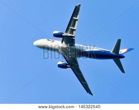 Moscow region - 31 July 2016: A beautiful white and blue passenger plane Airbus A320-214 Ural Airlines flies to Domodedovo airport July 31 2016 Moscow Region Russia