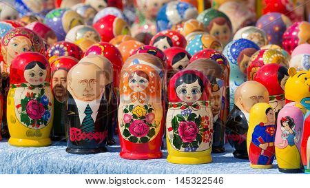 Moscow - August 11 2016: Lots of colorful dolls matryoshka dolls and with Putin's image in the window of a souvenir shop August 11 2016 Moscow Russia